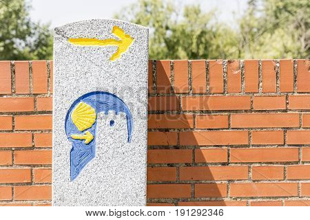 way of Saint James signpost against a brick wall - Camino Mozarabe de Santiago