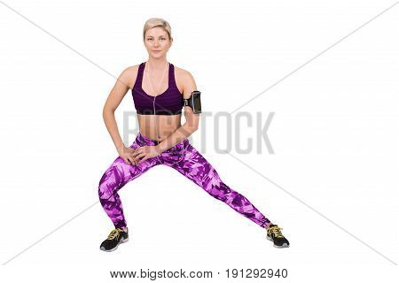 Fitness young woman doing stretching isolated on white background.