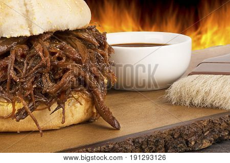 Close up on pulled pork sandwich flame background.
