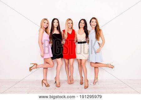 Full Length Of Excited Girlfriends In Colorful Short Cocktail Dresses Are Ready For Birthday Celebra