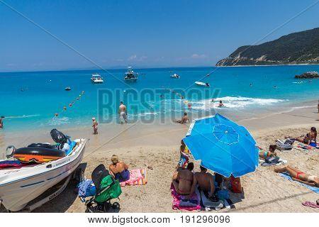 AGIOS NIKITAS, LEFKADA, GREECE JULY 16, 2014: Blue waters of beach of village of Agios Nikitas, Lefkada, Ionian Islands, Greece