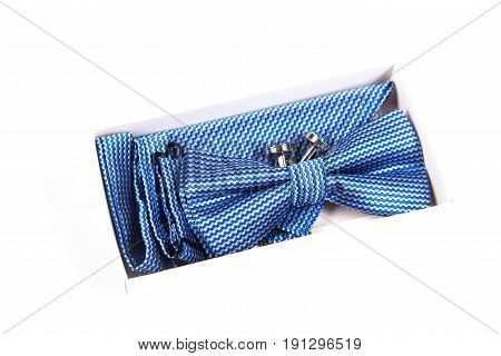 Blue bow tie with a pattern on a white background. Accessory for formal dress. Men's and women's accessories. Men's and women's bow tie. Hipster style.
