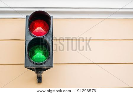 Two color traffic light on the wall