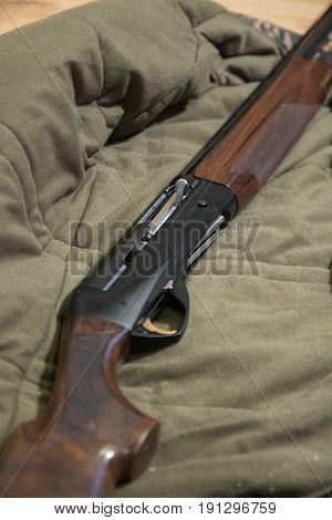 Semi-automatic Hunting Rifle, Close-up View Of Shotgun, Green Jacket