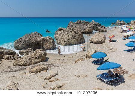 MEGALI PETRA BEACH, LEFKADA, GREECE JULY 16, 2014: Panoramic view of blue waters of Megali Petra Beach, Lefkada, Ionian Islands, Greece
