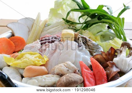 Korean seafood and pork belly hot pot on table isolated white backgroundFood concept