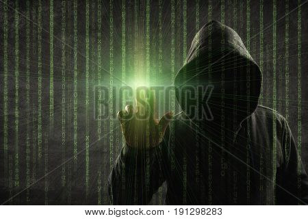 hacker over a screen with binary code