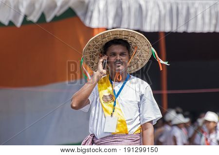 KOLKATA WEST BENGAL / INDIA - AUGUST 15TH 2016 : Man dressed in villager's dress talking in mobile as a symbol of digital India campaign to celebrate on India's Independence day. Celebrated all over India .