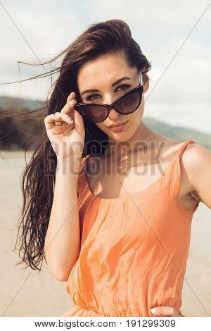 Pretty Girl In Sunglasses On The Beach.