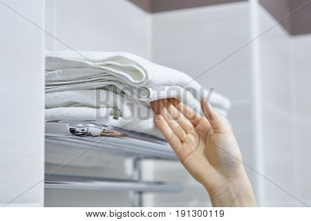 White towels, towels are on the shelf, a pile of towels.