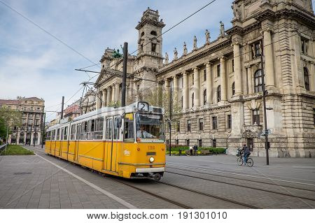 Budapest, Hungary - Avril 15, 2016: The Tram 2 In The Background Is The Museum Of Hungarian Ethnogra