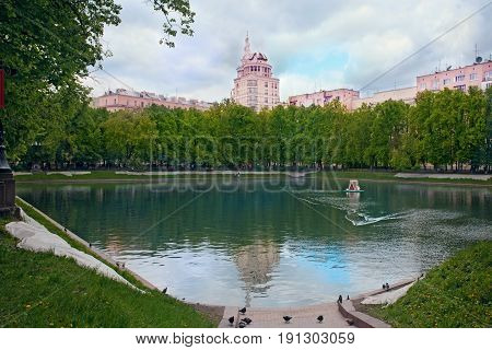 Park with Patriarshiye ponds among residential houses at summer. Moscow