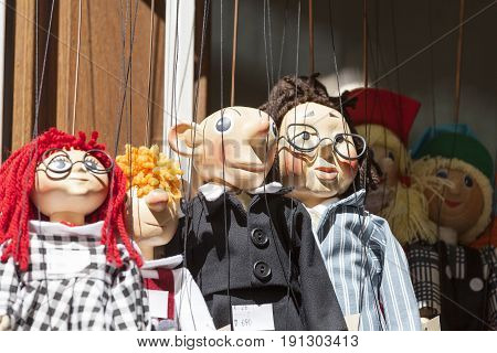 PRAGUE CZECH REPUBLIC - MAY 2 2017: Traditional colorful puppets made of wood in shop.In Prague there are many gift shops selling colorful puppets these are characters from films stories and other
