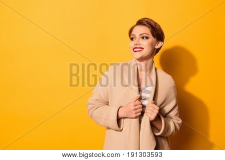 Portrait Of Pretty Young Girl With Beaming Smile Dressed In Beige Cardigan And Striped T-shirt Isola