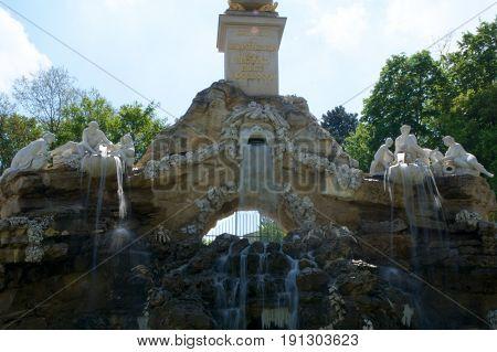 VIENNA, AUSTRIA - APR 30th, 2017: View of Obelisk Fountain Obeliskbrunnen in the public park of Schonbrunn Palace.