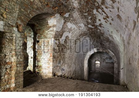 Old stone staircase leads to dungeon. Underground ruins. Destroyed fort Tarakanivsky. Dubno. Ukraine.