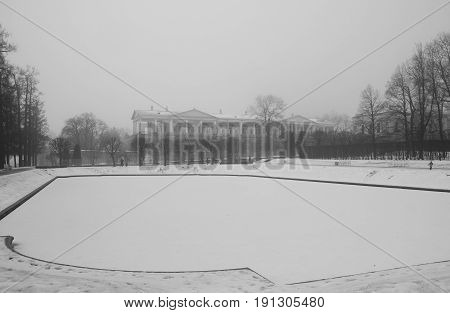 Thaw fog Mirror Pond and Cameron Gallery in Catherine park in Tsarskoye Selo