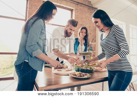 Together is more fun and faster. After party. Friends are cleaning a table with plates and glasses. They help each other