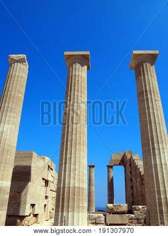 the acropolis and lindos in rhodes with columns and ruins