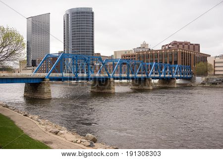 The city of Grand Rapids next to the Grand River in Michigan USA