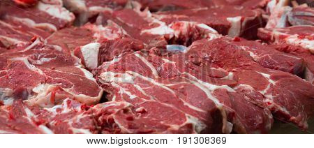 Pieces of fresh beef lying on the counter on the market. Red meat