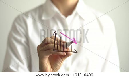 Woman drawing decrease diagram with red down arrow on transparent screen. Businesswoman write on board. Business failure concept.