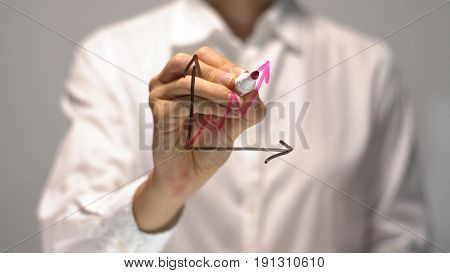 Woman drawing Gradual Rise diagram with red up arrow on transparent screen. Businesswoman write on board. Business success concept.