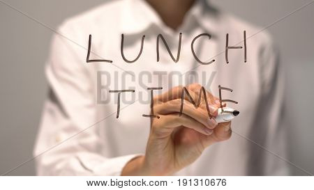 Woman writing Lunch Time on transparent screen. Businesswoman write on board. Businesswoman write on board. Success concept.