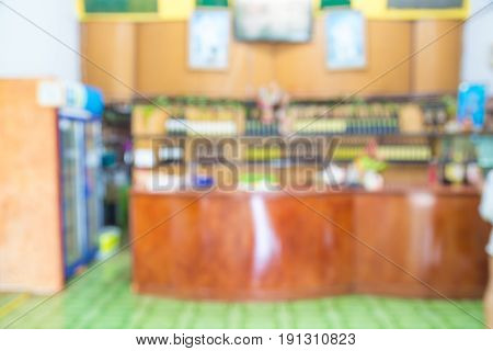 Abstract Blur Background of Cashier Counter with Shelf of Grape Wine and Liquor in Local Supermarket