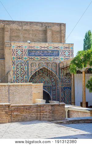 Blue mosaic on facade at Shah i Zinda mausoleum Samarkand Uzbekistan