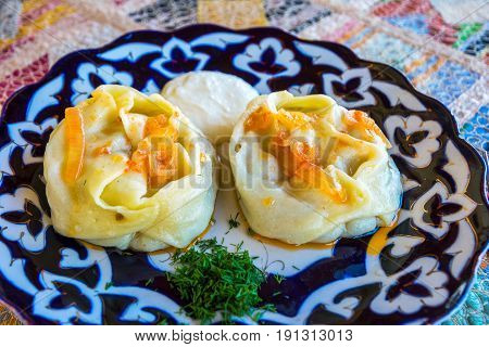 Traditional freshly cooked manty (dumplings) served on the plate