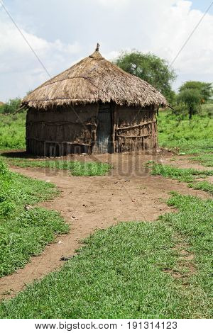 a traditional Masai wooden house in Tanzania