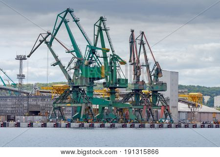 Large port cranes in the seaport of Gdynia. Port of Gdynia is a major transport hub in the Baltic Sea.