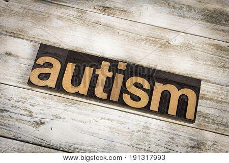 Autism Letterpress Word On Wooden Background