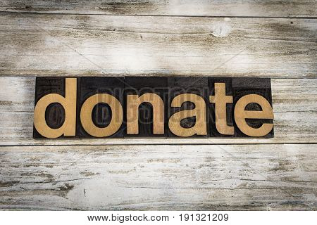 Donate Letterpress Word On Wooden Background
