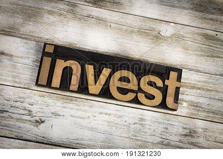 Invest Letterpress Word On Wooden Background