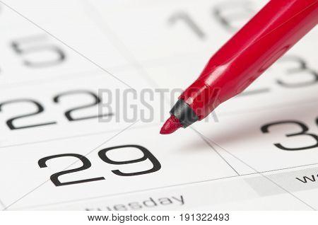 Red Pen Over Calendar