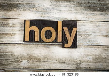Holy Letterpress Word On Wooden Background