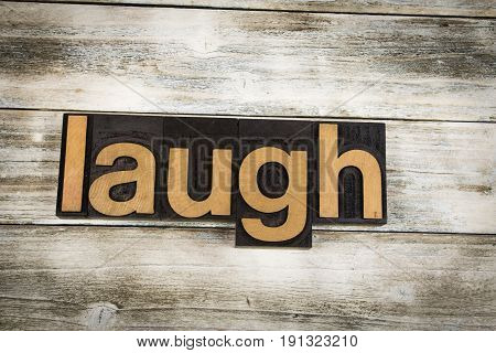 Laugh Letterpress Word On Wooden Background