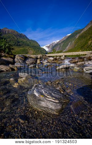Beautiful view of Franz Josef Glacier in Westland National Park on the West Coast of South Island. Southern Alps mountains.