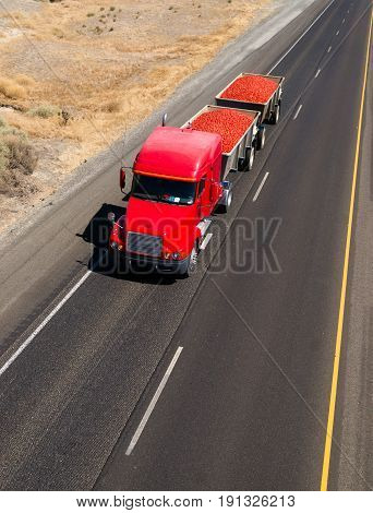 A big red dual freight hauler carries food to market