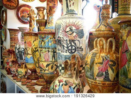 RODOS ISLAND, GREECE, JUNE 22, 2013: View on hand made painted classical greek stone jug, stoneware jug, pitchers, claret-jugs, jugfuls at workshop. Famous Greece miths mythology