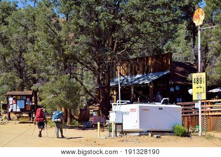June 13, 2017 in Kennedy Meadows, CA:  Backpackers hiking to the Kennedy Meadows General Store which is on the PCT Hiking Trail that traverses from The California/Mexico border to the Washington/Canada border where people hike the whole trail