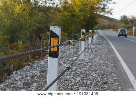 Traffic Barrier safety road on road. Close up asphalt road texture with white stripe. The car on the road