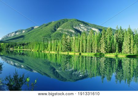 Mountain reflection in the water in Banff National Park