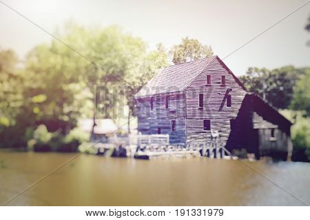 A blurred tilt-shift view of Yates Millpond in Raleigh North Carolina.