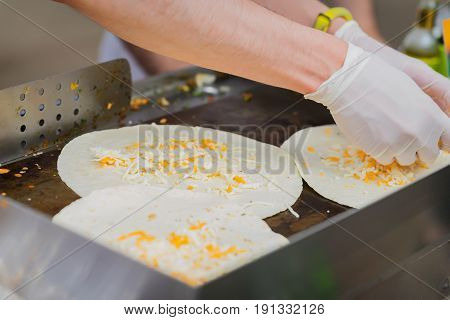 Making tortilla for mexican food, hands cook for healthy fresh fajitas or fajitos with cheese. Party food. Concept of national food, healthy fast food, recipes and cooking