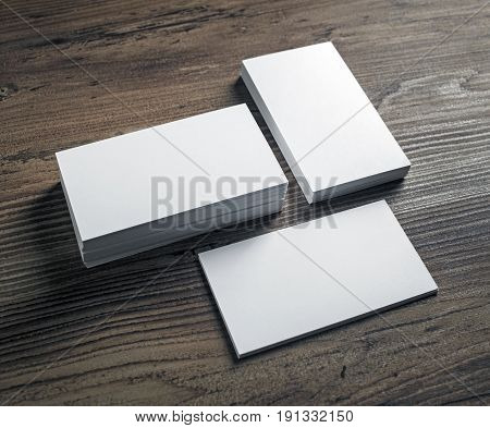 Mockup of blank business cards stack on wooden table background. Template for ID. Mock-up for branding identity.