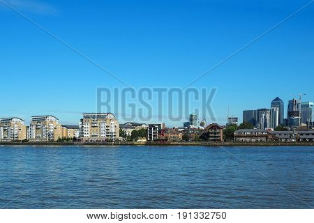 The view of river Thames and Canary Wharf business centre in London UK seen from Greenwich.