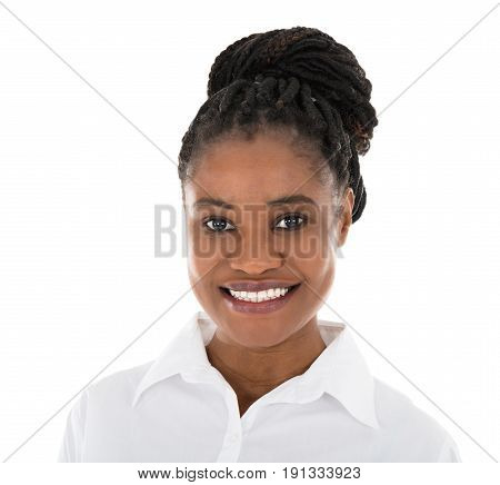 Portrait Of Happy African Hostess Standing Arms Crossed Against White Background